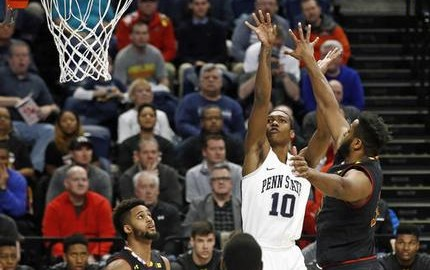 Penn State's Tony Carr (10) puts up a shot against Maryland's Damonte Dodd (35) during the first half of an NCAA college basketball game in State College, Pa., Tuesday, Feb. 7, 2017. (AP Photo/Chris Knight)